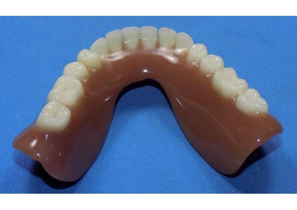Cleaned & polished lower denture